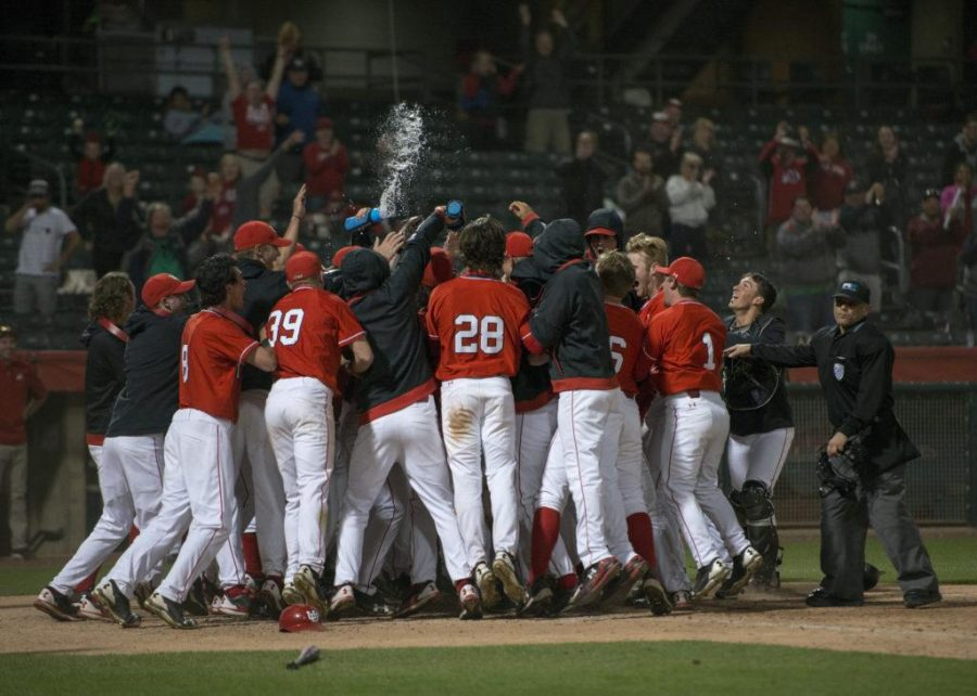 The University of Utah Men's Baseball team celebrates after junior infielder Wade Gulden (7) hits a walk-off two run homerun in a Pac-12 game vs. the USC Trojans at Smith's Ballpark on Monday, May 15, 2017  (Photo by Kiffer Creveling | The Daily Utah Chronicle)