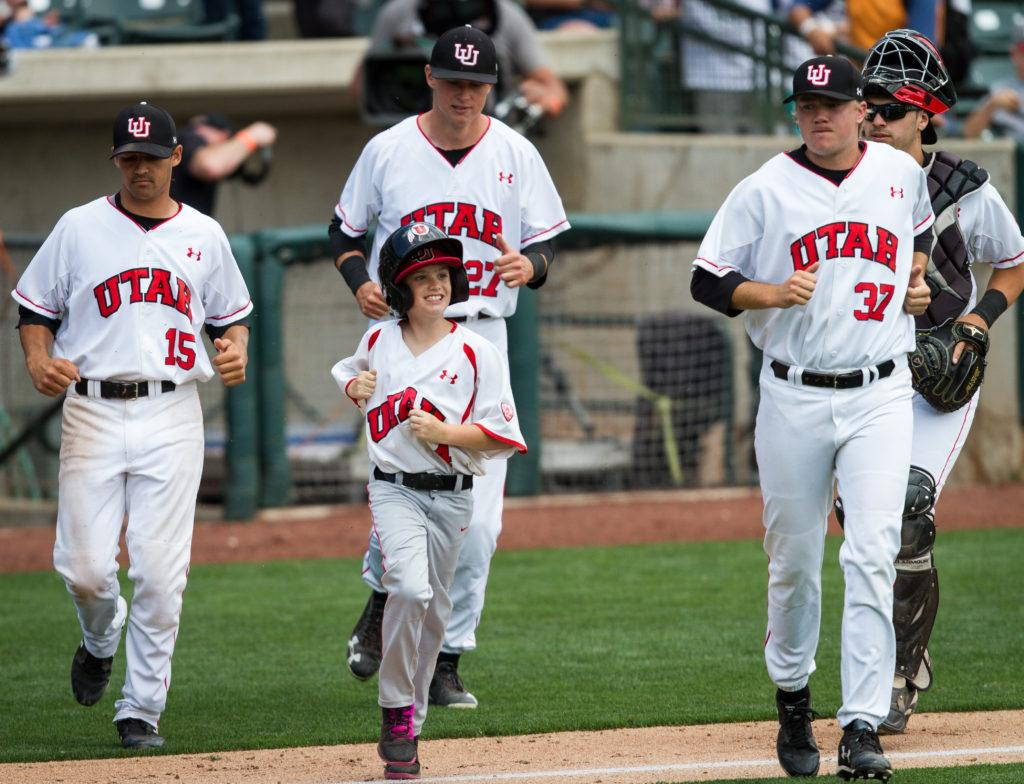 University of Utah Baseball's batboy Graden Miller (4) jogs out following the 2-0 victory in an PAC 12 Game vs. The Arizona State Sun Devils at The Salt Lake Bee's Stadium, Salt Lake City, UT on Friday, May 26, 2017  (Photo by Adam Fondren | Daily Utah Chronicle)