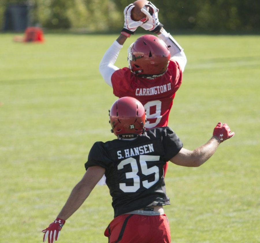 Utah wide receiver Darren Carrington II (9) catches the football in front of defensive back Shawn Hansen (35) during the first day of Preseason Football Camp at the U Eccles Football Center in Salt Lake City, Utah on Friday, Jul. 28, 2017. (Rishi Deka  |  Daily Utah Chronicle)