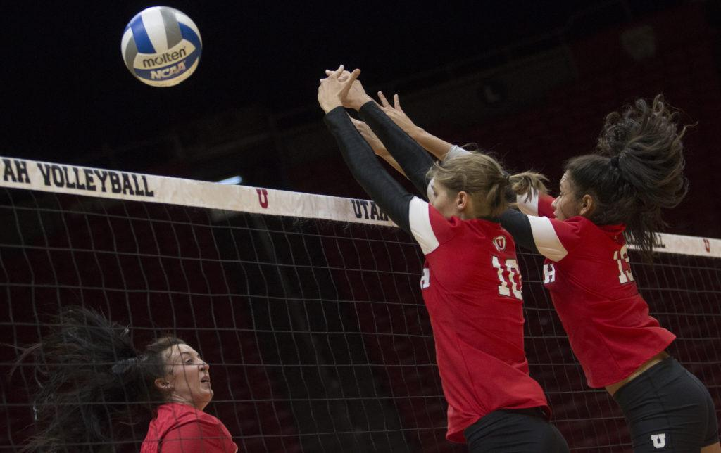 Carly Trueman (10) and Phoebe Grace (19) block the ball during the Utah Women's Volleyball Red vs. White Scrimmage at the U Hunstman Center in Salt Lake City, Utah on Saturday, Aug. 19, 2017. (Dr. Rishi Deka  | Daily Utah Chronicle)