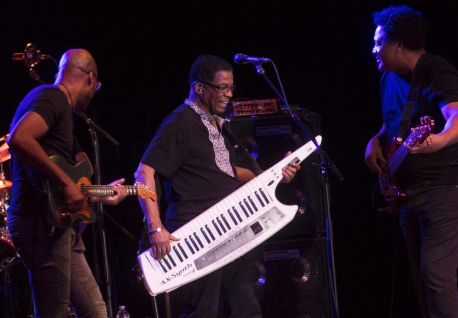 Herbie Hancock plays the keytar while Lionel Loueke, left, and James Genus, right, perform at Red Butte Garden in Salt Lake City, Utah on Sunday, Aug. 20, 2017. (Dr. Rishi Deka | Daily Utah Chronicle)
