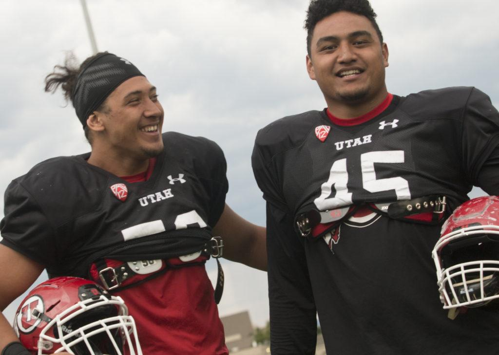 Bradlee Anae, left, and Filipo Mokofisi, right, pose for a photo at the Spence and Cleone Eccles Football Facility on Tuesday, Aug. 22, 2017. (Rishi Deka | Daily Utah Chronicle)