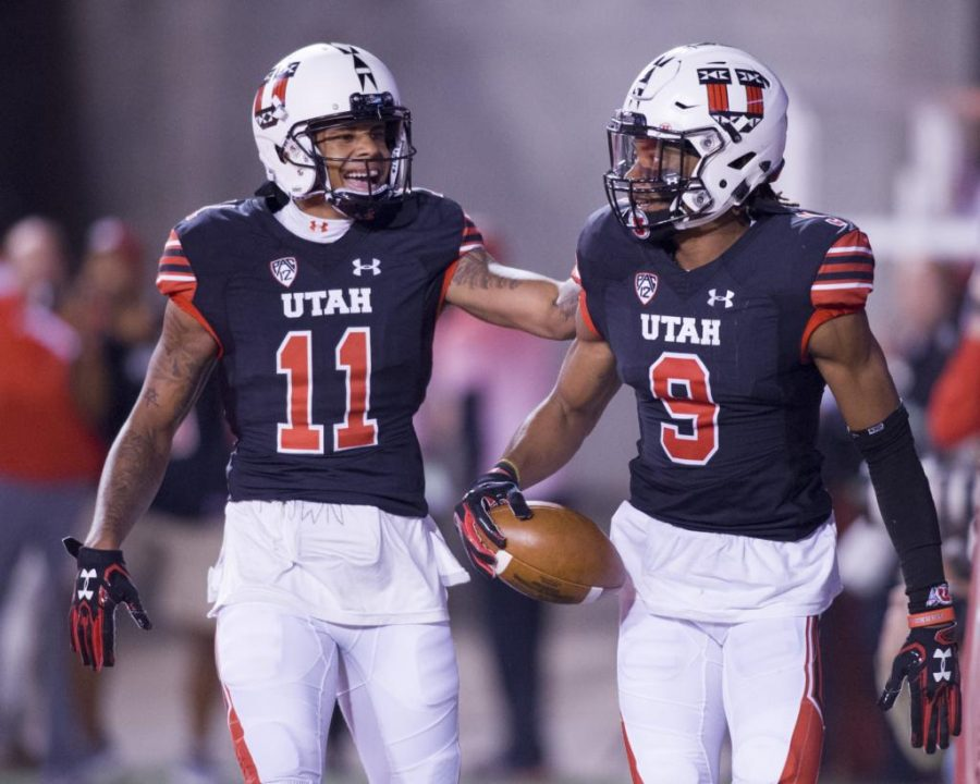 University of Utah junior wide receiver Raelon Singleton (11) congratulates senior wide receiver Darren Carrington II (9) on his touchdown in an NCAA Football game vs. The San Jose State Spartans in Rice Eccles Stadium in Salt Lake City, Utah on Saturday, Sept. 16, 2017  (Photo by Kiffer Creveling | The Daily Utah Chronicle)
