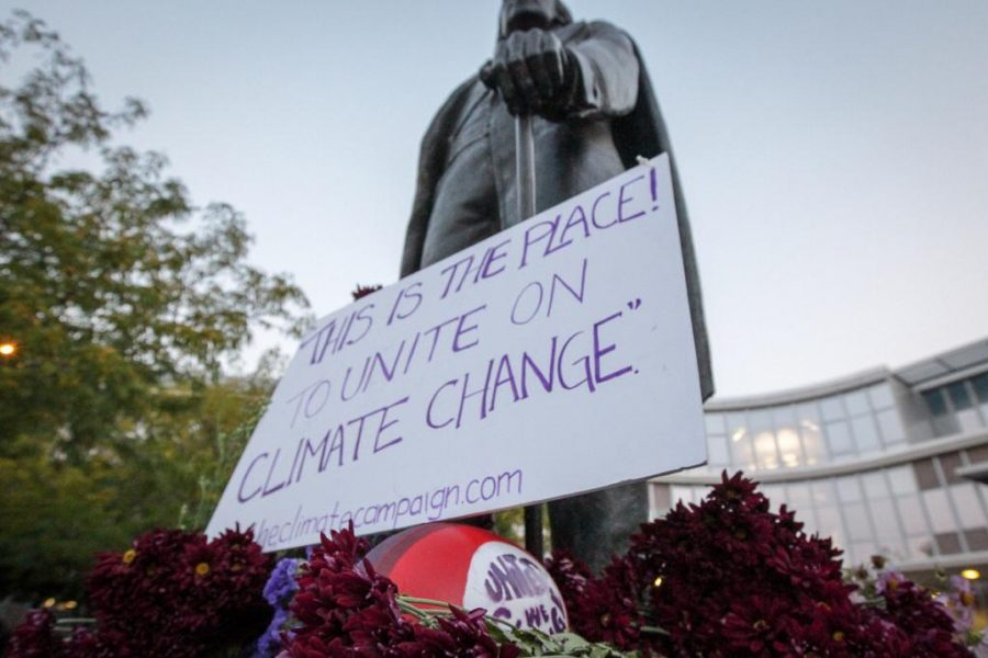 A statue of the schools namesake at Brigham Young University was decorated by University of Utah students involved with The Climate Campaign to raise awareness about climate change.