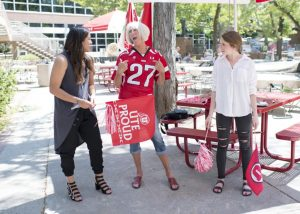 Terri Jackson, University of Utah's Crazy Lady, tells student media how she became the Crazy Lady as well as teaches them how to do the crazy dance at the Student Union building on Friday, Aug. 18, 2017  (Photo by Kiffer Creveling | The Daily Utah Chronicle)