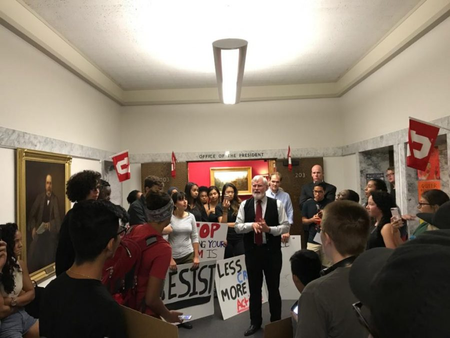 University+of+Utah+President+David+Pershing+speaks+to+protesters+outside+of+his+office+about+Ben+Shapiro+coming+to+speak+at+the+school.