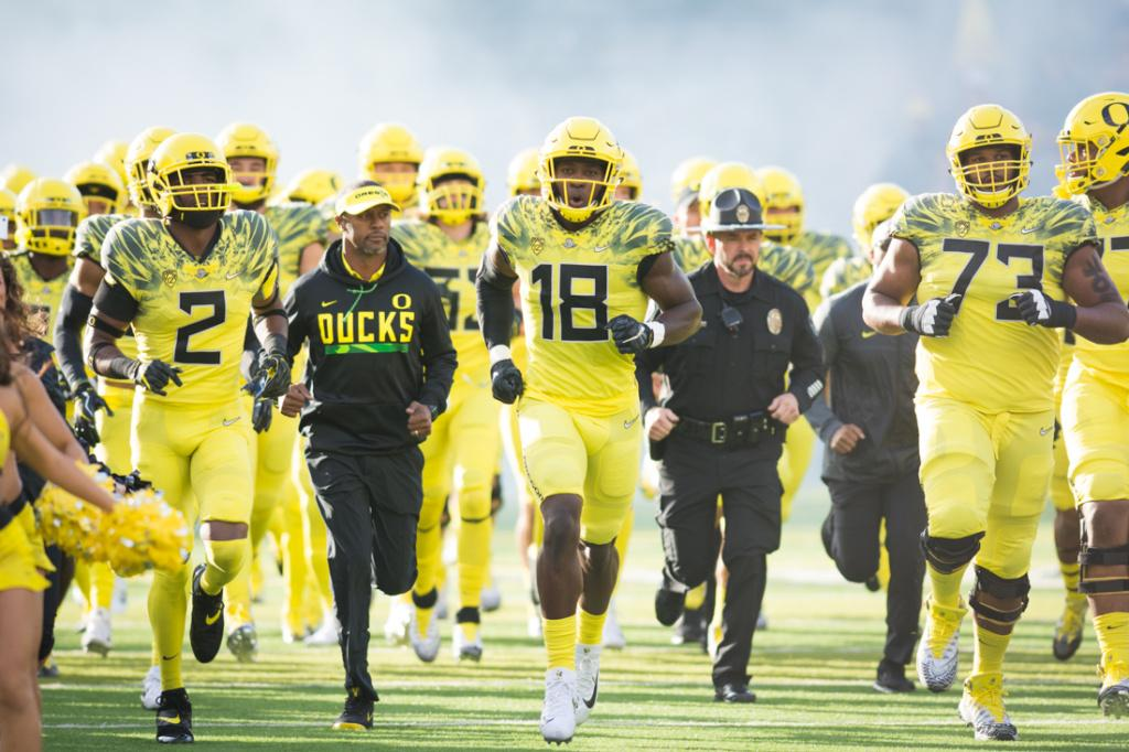 The Oregon Ducks run out with Coach Willie Taggart before the game starts. The Oregon Ducks host the No. 11 Washington State Cougars at Autzen Stadium in Eugene, Ore. on Saturday, Oct. 7, 2017. (Amanda Shigeoka/Emerald)