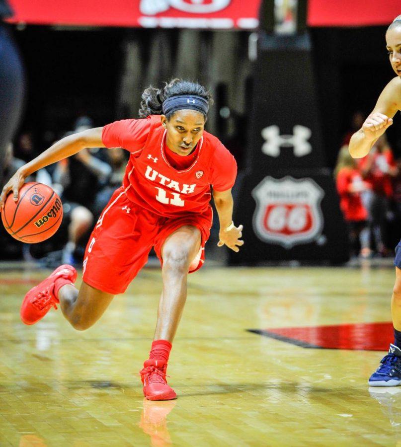 Sophmore Erika Bean Dribbles the ball down court. Utah Vs. BYU December 10,2016. Adam Fondren The Utah Chronicle