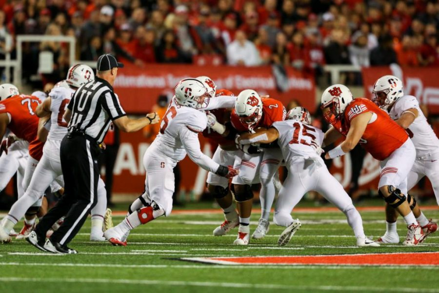 Zack Moss runs through defenders as Utah Utes Football takes on Stanford Cardinals at Rice-Eccles Stadium in Salt Lake City, UT on Saturday, October7, 2017.   (Photo by Curtis Lin/Daily Utah Chronicle)