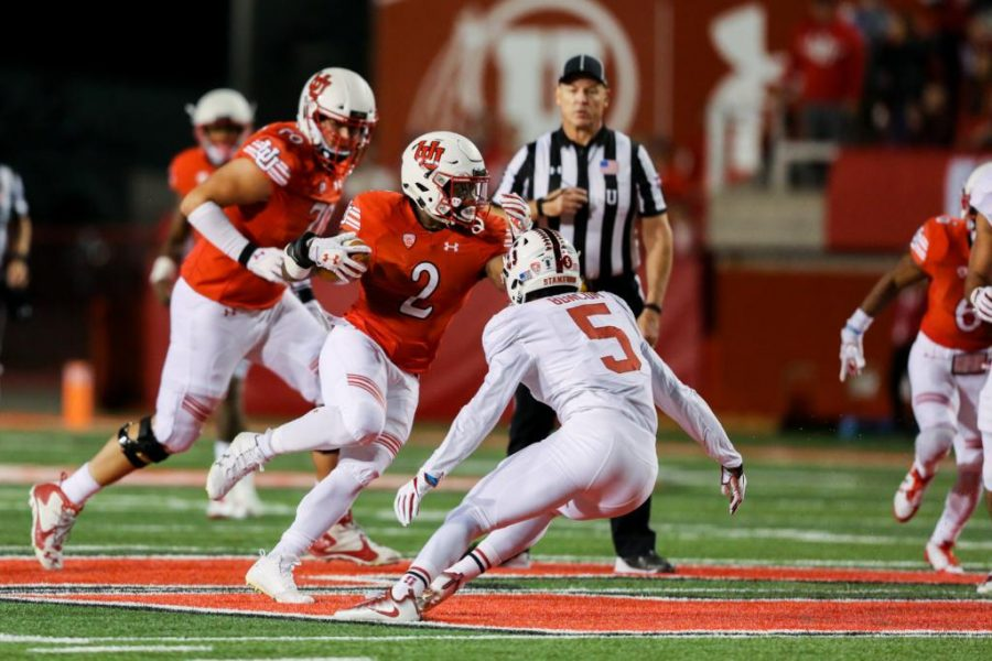 Zack Moss dodges defenders as Utah Utes Football takes on Stanford Cardinals at Rice-Eccles Stadium in Salt Lake City, UT on Saturday, October7, 2017.   (Photo by Curtis Lin/Daily Utah Chronicle)