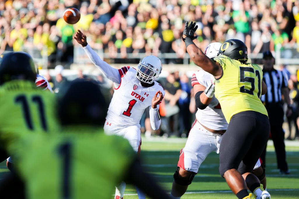 Sophomore quarterback Tyler Huntley (1) throws a pass under pressure as the Utah Utes Football team take on the Oregon Ducks at Autzen Stadium in Eugene, OR on Saturday, October 28, 2017.   (Photo by Curtis Lin/Daily Utah Chronicle)