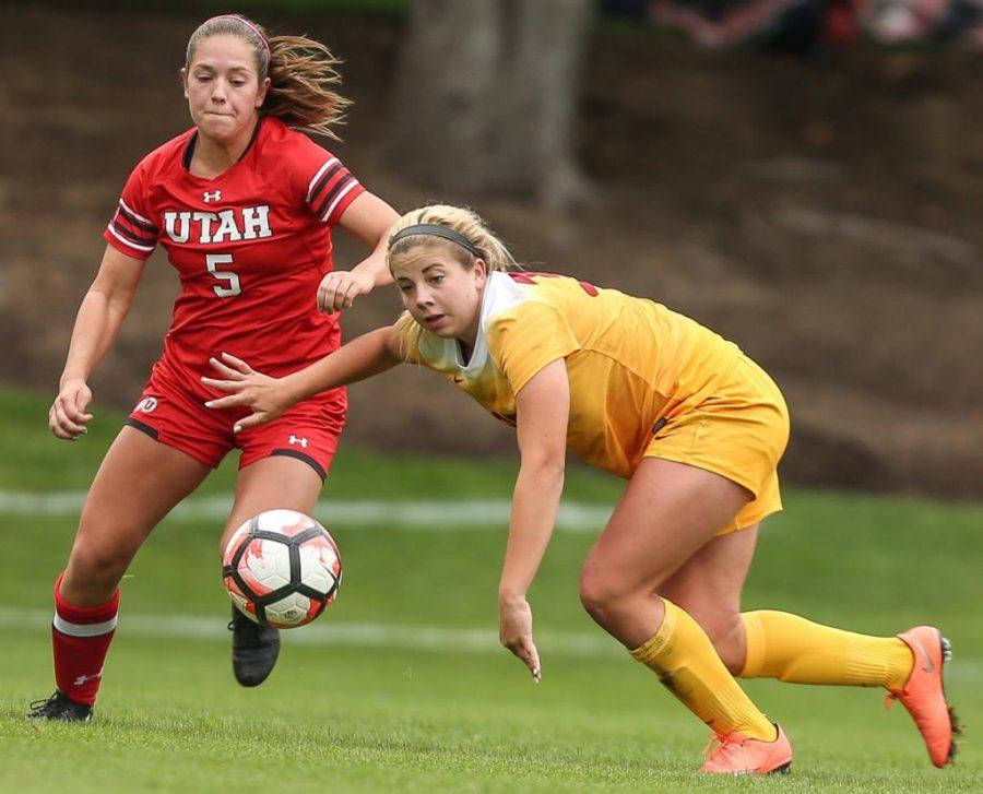 Janie Kearl (05) goes past a Trojan during the Utah Utes Womens soccer tie game versus University of Southern California at Ute Soccer Field in Salt Lake City, UT on Saturday, September 23, 2017.  (Photo by Cassandra Palor/ Daily Utah Chronicle)