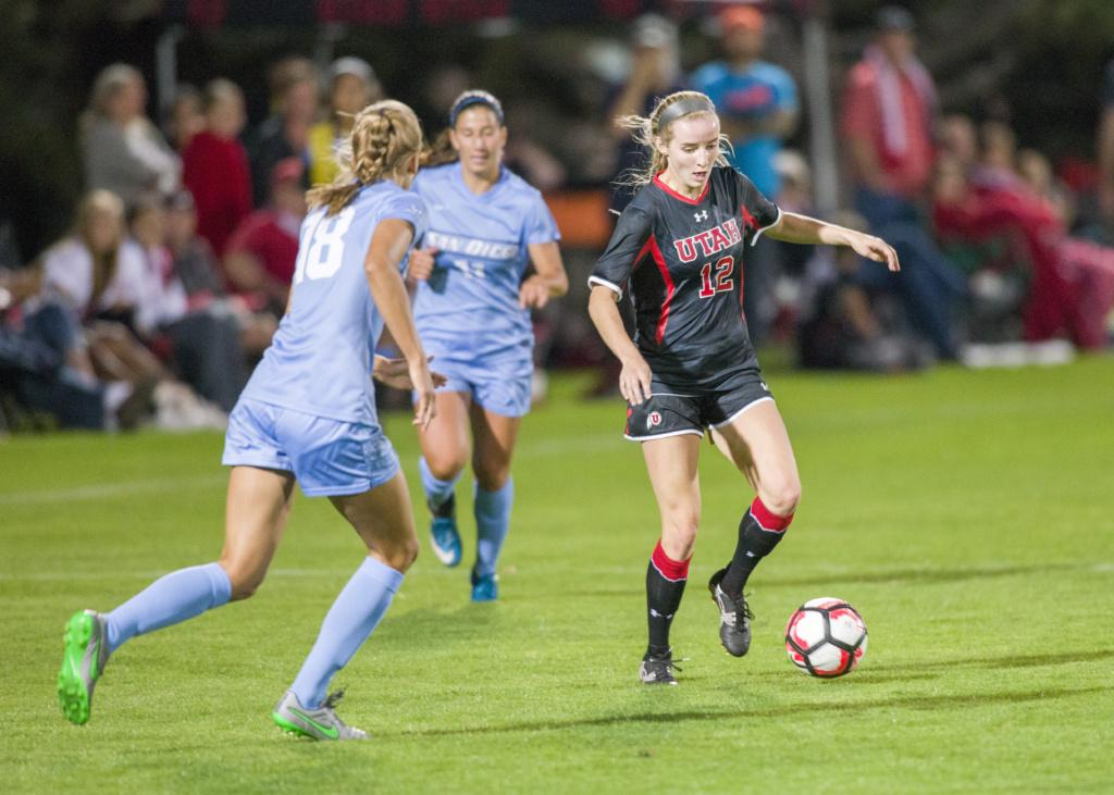 Utah women's soccer freshman Holly Daugirda (12) evades the defense vs San Diego at the Ute Soccer Field on Friday, August 26, 2016