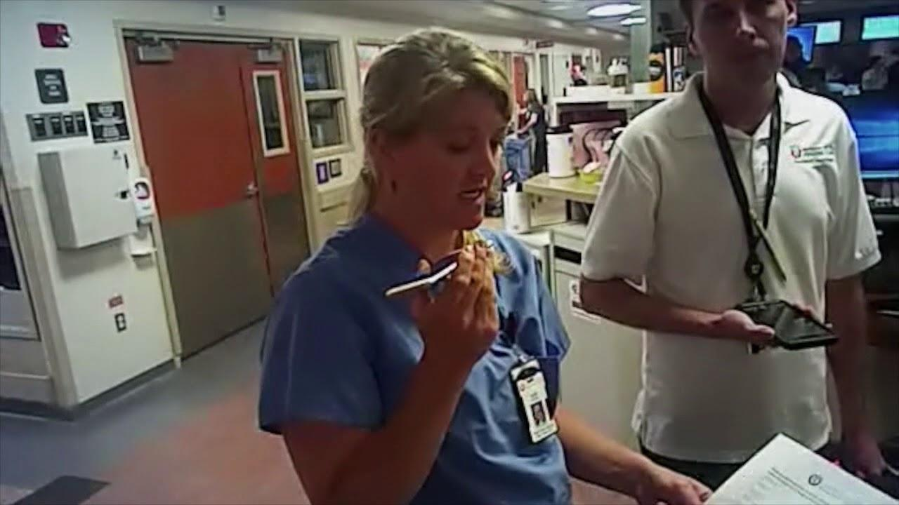 Body camera footage shows Salt Lake City Police Department Detective Jeff Payne arresting University of Utah Health nurse Alex Wubbles after she refused to draw blood from an unconscious patient.