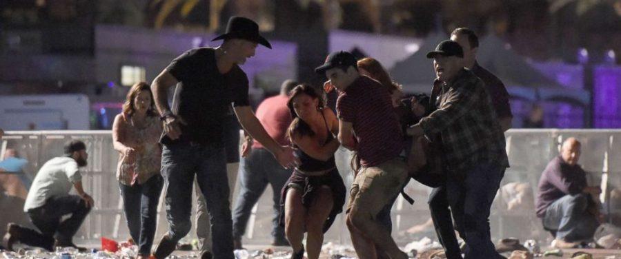 Concert+goers+in+Las+Vegas+flee+as+shooter+Stephen+Paddock+unleashes+on+the+crowd+below.