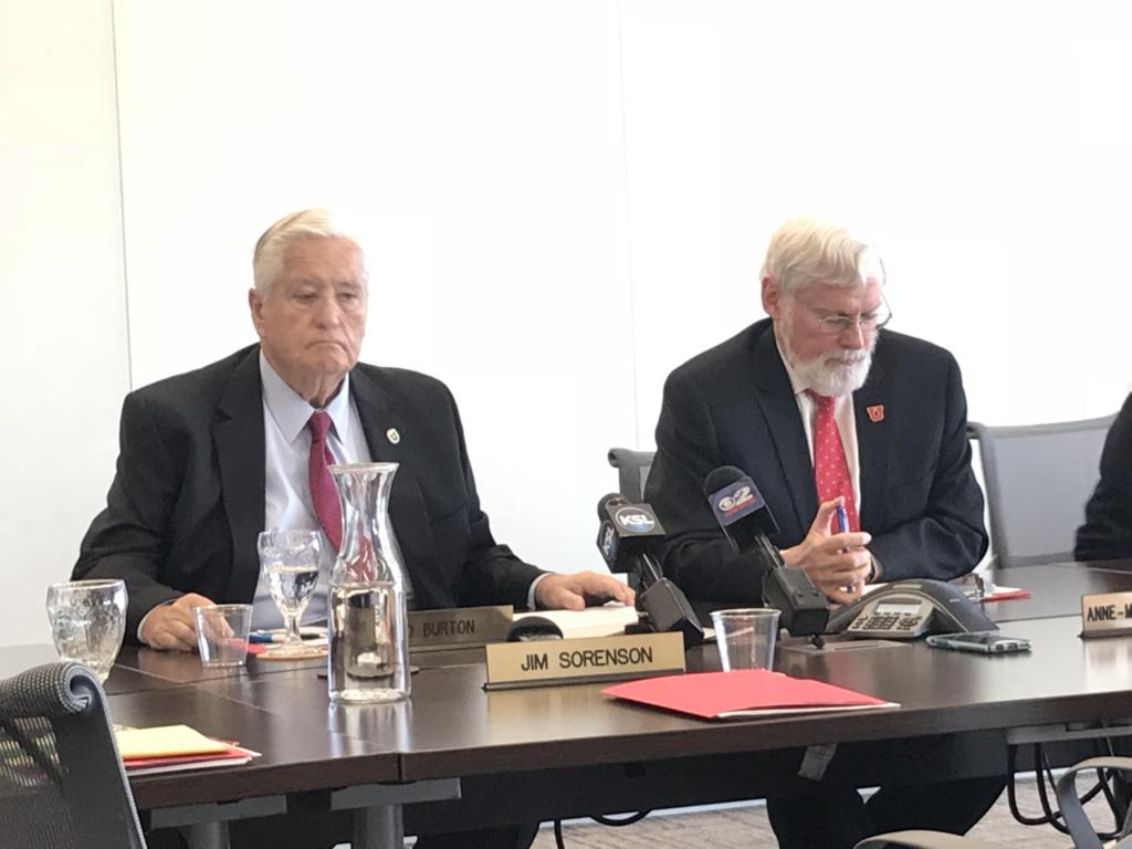 University of Utah Board of Trustees Chair H. David Burton and President David Pershing at an October 5, 2017 meeting, discussing a new memorandum of understanding with Huntsman Cancer Foundation over the operation of the Huntsman Cancer Institute.