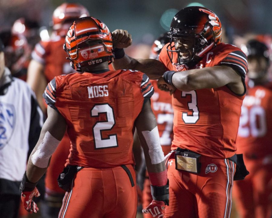 University of Utah senior quarterback Troy Williams (3) congratulates Zack Moss (2) after his touchdown in an NCAA Football game vs. The University of Colorado Buffs at Rice Eccles Stadium in Salt Lake City, Utah on Saturday, Nov. 25, 2017  (Photo by Kiffer Creveling | The Daily Utah Chronicle)