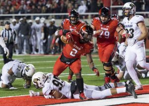 Football: Utah Becomes Bowl Eligible, Defeats Colorado, 13-34
