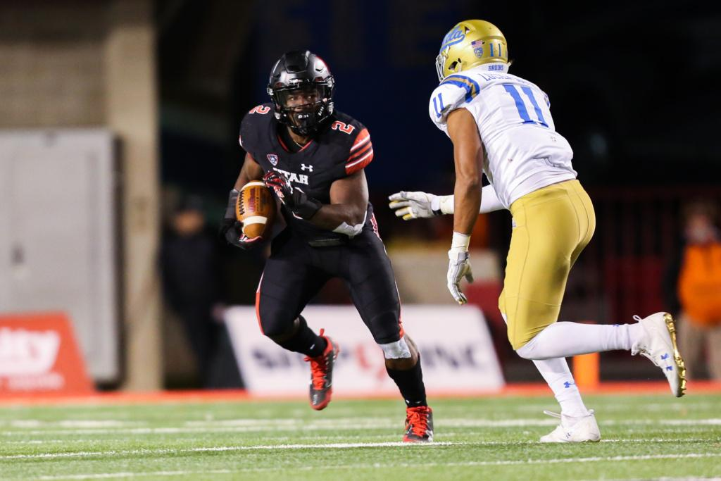 Sophomore running back Zack Moss (2) rushes as the Utah Utes Football team takes on the UCLA Bruins at Rice-Eccles Stadium in Salt Lake City, UT on Friday, November 3, 2017.   (Photo by Curtis Lin/Daily Utah Chronicle)