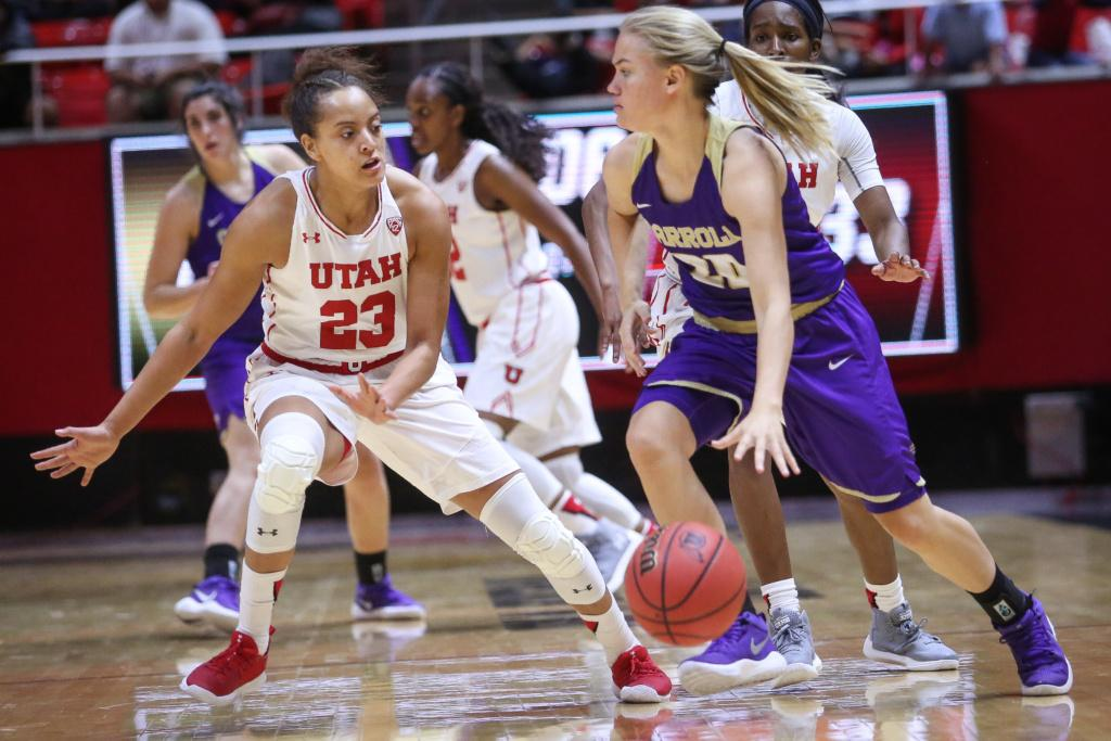 Daneesha Provo (23) guards Mikaela Dowdy (20) in the Utah Utes Women's basketball victory game over Carroll College at the Huntsman Center in Salt Lake City, Utah on Thursday, November 2, 2017.  (Photo by Cassandra Palor/ Daily Utah Chronicle)