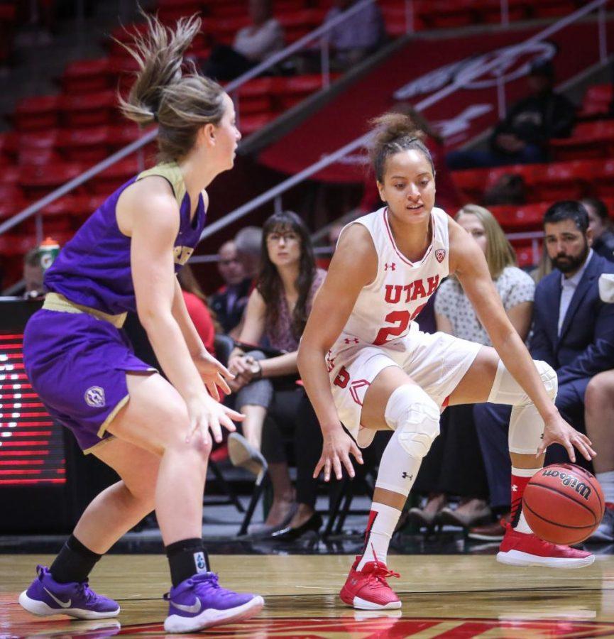 Daneesha Provo (0)  crosses the ball under her legs in the Utah Utes Womens basketball victory game over Carroll College at the Huntsman Center in Salt Lake City, Utah on Thursday, November 2, 2017.  (Photo by Cassandra Palor/ Daily Utah Chronicle)