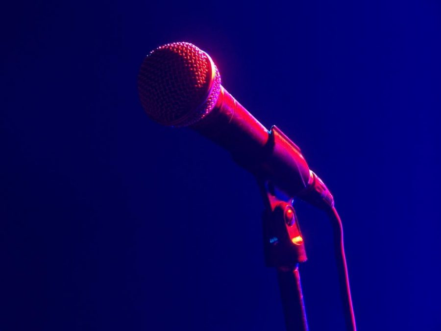 A lone microphone in colorful mood lighting