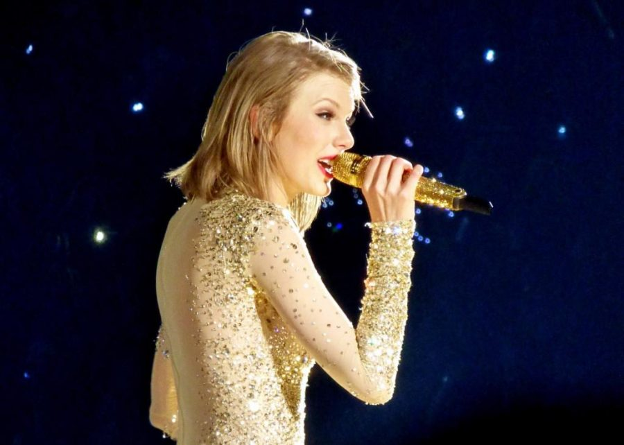 Taylor Swift sings into a golden microphone