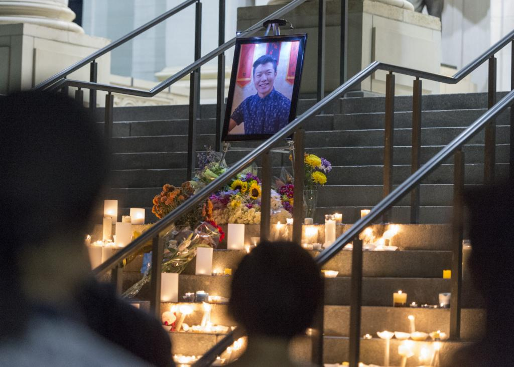 Students, staff, and friends of ChenWei Guo came to show their support after the recent shooting tragedy in Red Butte Canyon by lighting candles and walking from the Marriott Library to President's circle for a candle light vigil to share their condolences on Wednesday, Nov. 1, 2017 | Chronicle archive