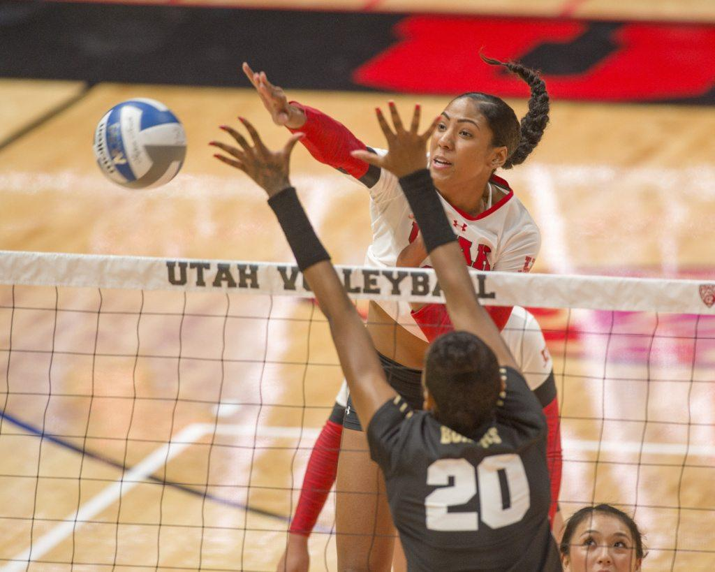University of Utah senior middle blocker Tawnee Luafalemana (20) spikes the ball over Purdue senior outside hitter Danielle Cuttino (20) in an NCAA Volleyball match vs. The Purdue Boilermakers at the Jon M. Huntsman Center in Salt Lake City, Utah on Friday, Dec. 1, 2017  (Kiffer Creveling | The Daily Utah Chronicle)