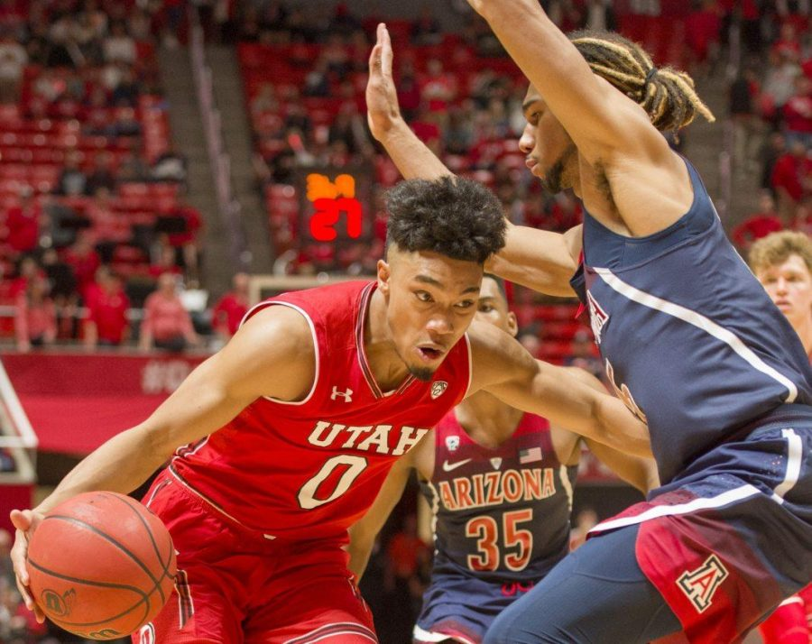 University+of+Utah+junior+guard+Sedrick+Barefield+%280%29+drives+towards+the+basket+around+University+of+Arizona+senior+forward+Keanu+Pinder+%2825%29+during+an+NCAA+Basketball+game++at+the+Jon+M.+Huntsman+Center+in+Salt+Lake+City%2C+Utah+on+Thursday%2C+Jan.+4%2C+2018.%0A%0A%28Photo+by+Kiffer+Creveling+%7C+The+Daily+Utah+Chronicle%29