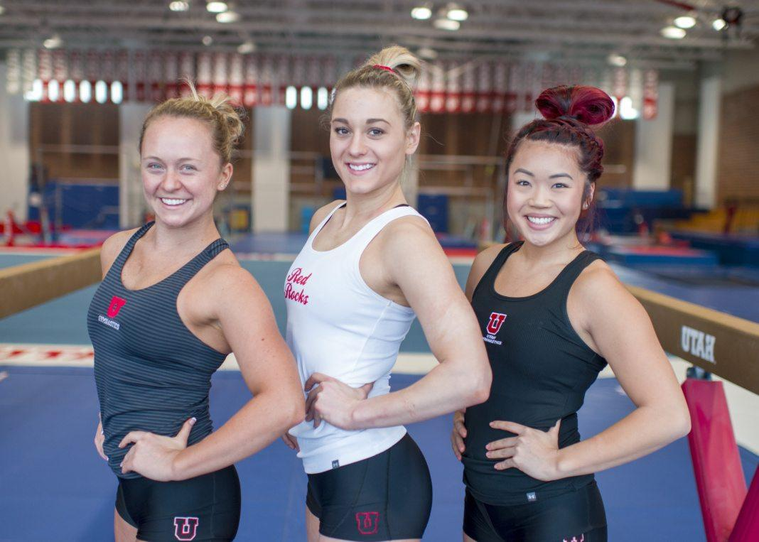 University of Utah women's gymnastics senior Maddy Stover (left), senior Tiffani Lewis (center), and junior Kari Lee (right) pose for a portrait at the Dumke Gymnastics Center in Salt Lake City, Utah on Thursday, Jan. 18, 2018.  (Photo by Kiffer Creveling   The Daily Utah Chronicle)
