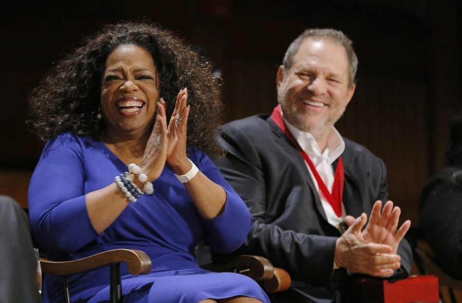 Entertainer+Oprah+Winfrey+%28L%29+and+producer+Harvey+Weinstein+laugh+before+receiving+W.E.B.+Du+Bois+Medals+at+the+Hutchins+Center+Honors+at+Harvard+University+in+Cambridge%2C+Massachusetts+September+30%2C+2014.+