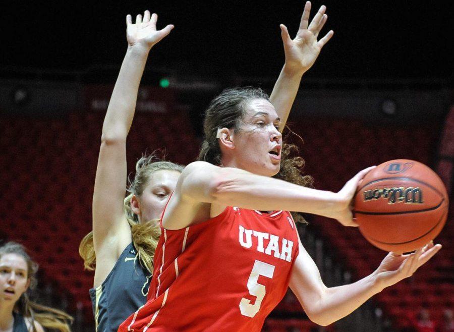 Utah Utes center Megan Huff (5) offloads a pass as the Lady Utes take on the Colorado Buffalos at the Huntsman Center in Salt Lake, UT on Thursday, Feb. 1, 2018  (Photo by Adam Fondren | Daily Utah Chronicle)