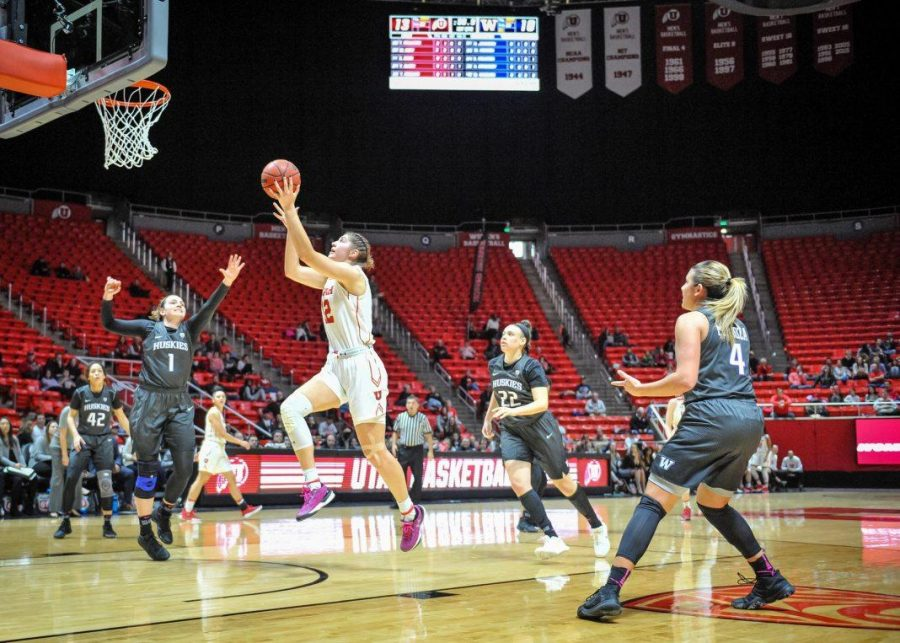 Utah Utes forward Emily Potter (12) takes a first half shot as the Lady Utes take on the Lady Huskies from the University of Washington at the Huntsman Center in Salt Lake City, UT on Sunday, Feb. 18, 2018  (Photo by Adam Fondren | Daily Utah Chronicle)