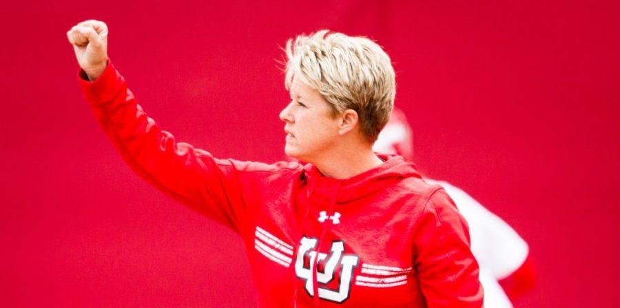 University of Utah Women's Softball Team head coach Amy Hogue giving signals to her base runners in an NCAA Regional Game vs. The Brigham Young University Cougars at Dumke Family Softball Stadium, Salt Lake City, UT on Friday, May 19, 2017  (Photo by Adam Fondren   Daily Utah Chronicle)