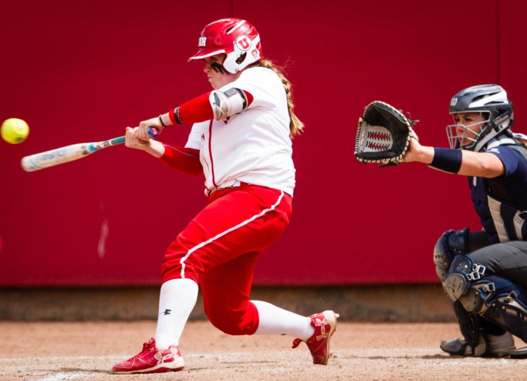 University of Utah Women's Softball Team freshman catcher Kelly Martinez (22) makes contact in the bottom of the 7th in an NCAA Regional Game vs. The Brigham Young University Cougars at Dumke Family Softball Stadium, Salt Lake City, UT on Friday, May 19, 2017  (Photo by Adam Fondren | Daily Utah Chronicle)