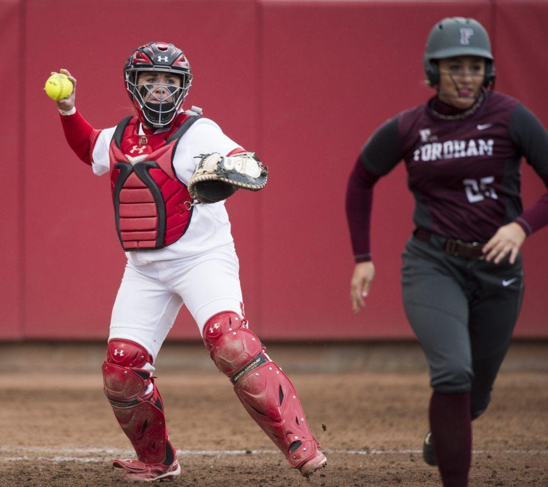 University of Utah Women's Softball Team freshman catcher Kelly Martinez (22) picks up the bunt from senior right handed pitcher/infielder Lauren Quense (25) and throws to first for the out in an NCAA Regional game vs. the Fordham Rams at Dumke Family Softball Stadium on Thursday, May 18, 2017  (Photo by Kiffer Creveling | The Daily Utah Chronicle)