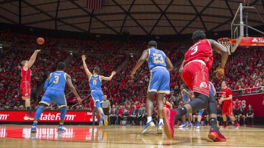 University of Utah senior forward Tyler Rawson (21) takes a jump shot over UCLA Bruins defense during an NCAA Basketball game at the Jon M. Huntsman Center in Salt Lake City, Utah on Thursday, Feb. 22, 2018.  (Photo by Kiffer Creveling | The Daily Utah Chronicle)