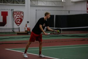 Utah mens tennis defended their home courts against Pacific University and Northern Arizona on Saturday Feb. 3. Joe Woolley prepares to serve against Pacific.  Photo by Justin Prather / Daily Utah Chronicle