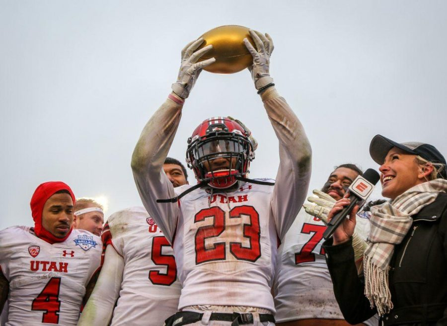Game MVP defensive back Julian Blackmon (23) raises the MVP trophy after the Zaxbys Heart of Dallas Bowl between the Utah Utes and the West Virginia Mountaineers in Dallas Texas on Tuesday, Dec. 26, 2017.