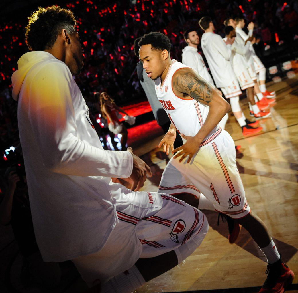 Utah Utes forward Chris Seeley (11) welcomes starter Utah Utes guard Justin Bibbins (1) during the announcement of the starting line-up before the game against the the Colorado Buffaloes in Salt Lake City, UT on Saturday, March 3, 2018