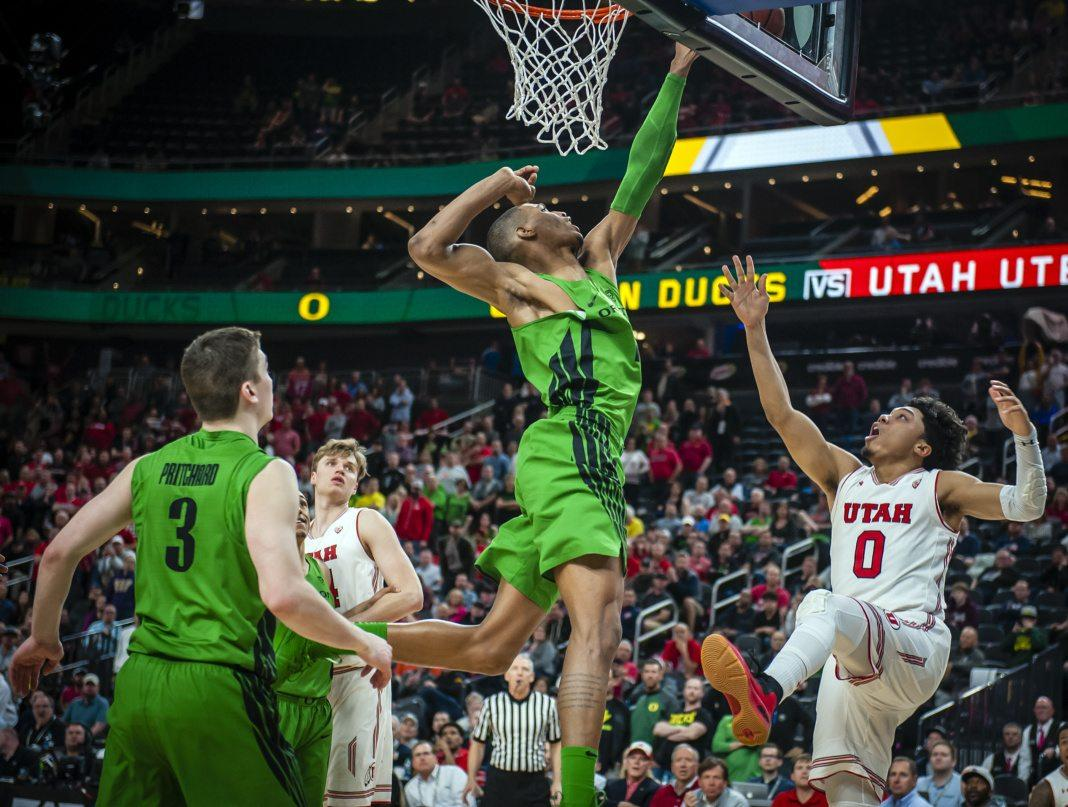 Utah Utes guard Sedrick Barefield (0) has the final shot of the game blocked by Oregon Ducks forward Kenny Wooten (1) as the University of Utah Running Utes lose to the Oregon Ducks 68-66 in the quarterfinal round of the PAC-12 Tournament in Las Vegas, NV on Friday, March 9, 2018