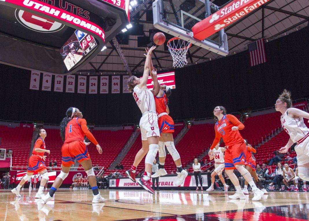 University of Utah senior forward Emily Potter (12) makes a layup in an NCAA Women's Basketball game vs. The University of Texas Arlington Mavericks at the Jon M. Huntsman Center in Salt Lake City, Utah on Monday, Nov. 27, 2017