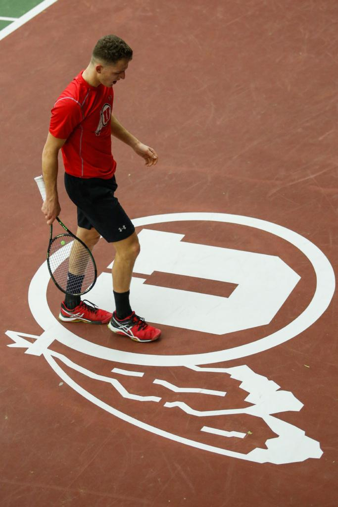 The Utes Men's tennis team hit the courts against the University of Montana's Grizzlies this Saturday Feb. 19.  Slava Shainyan rests for a moment between points.