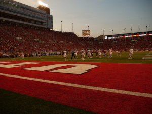 Football: Tuttle Acts As a Veteran Quarterback