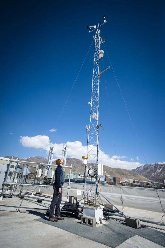 Logan Mitchell, Ph.D., Post Doctoral Scholar, looks up at the rooftop gathering station elements at the U-ATAQ (Utah Atmospheric Trace Gas and Air Quality) lab of the University of Utah's Atmospheric Sciences in the Browning Building on the University of Utah campus in Salt Lake on March 12, 2018.