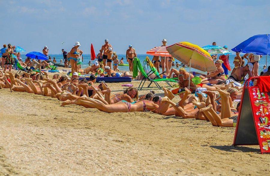 Beachgoers enjoying the beach.