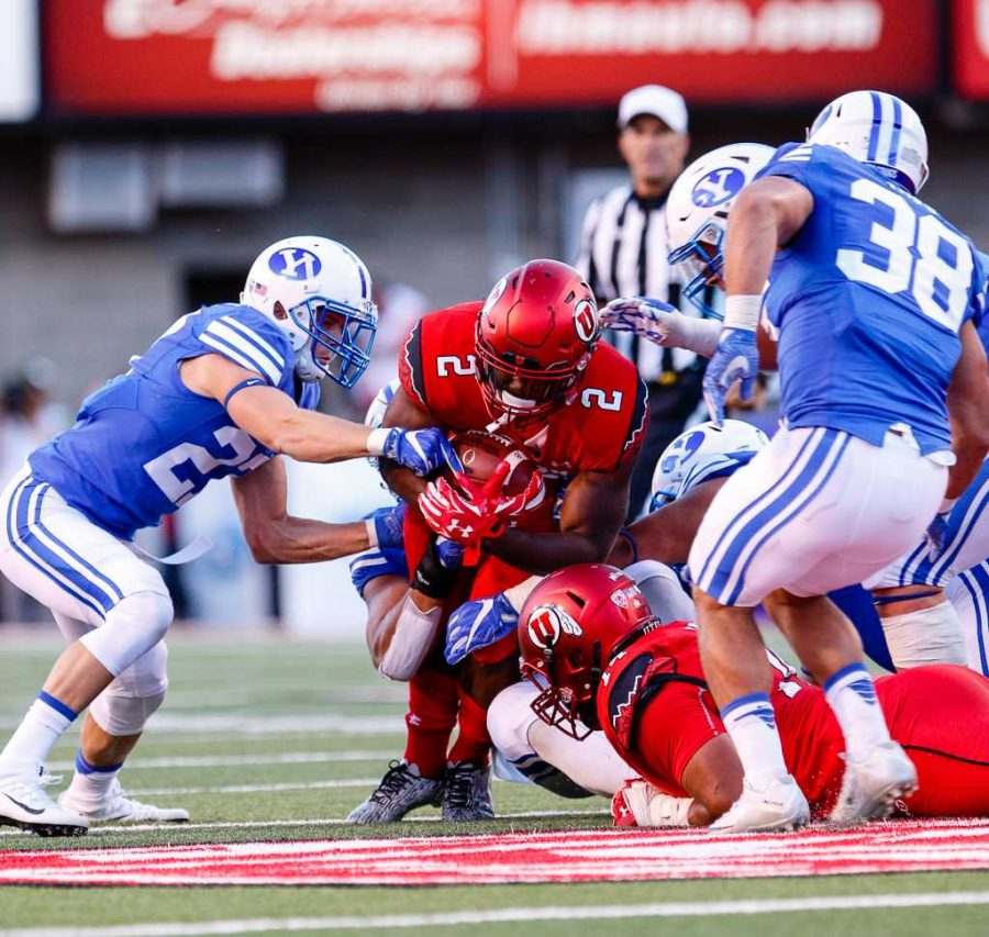 Zack Moss Fr. RB (2) Holds tight to the ball while breaking the BYU defense at Rice Eccles Stadium September 10, 2016 Adam Fondren