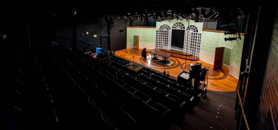 Teresa Vibanco and Halee Rasmussen work on a set piece inside the Babcock Theater, Nov 8, 2016. Adam Fondren Daily Utah Chronicle.