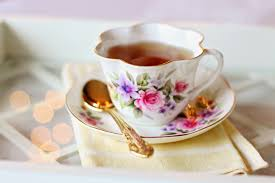 Delicious tea served in a floral cup.